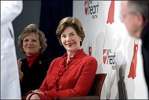 First Lady Laura Bush sits with Lois Ingland, ...