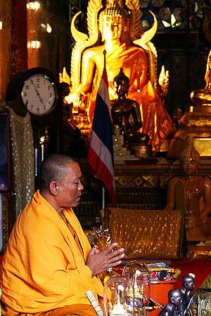 English: Monk praying, Thailand