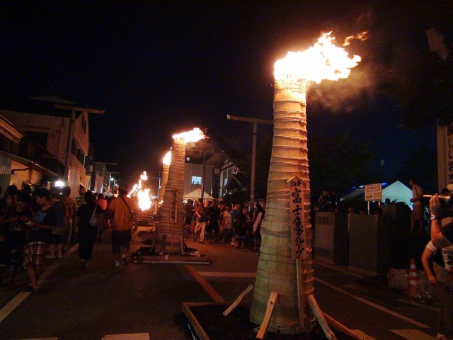 Torches burning Yoshida Fire Festival A.JPG