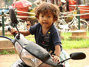 English: Cambodian child outside Angkor Wat te...