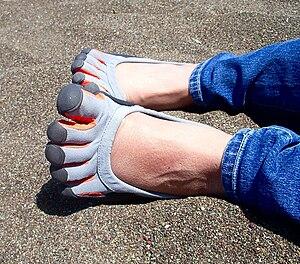 """A woman wears Vibram """"Five Fingers"""" ..."""