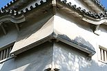 "Photo of two angled chutes or ""stone drop windows"" on a castle structure"