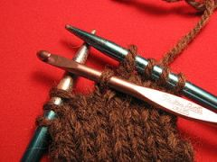 Photo showing how to pick up a dropped stitch ...