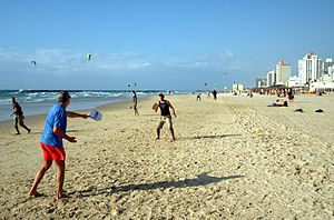 Matkot (beach tennis) players on the beach in ...