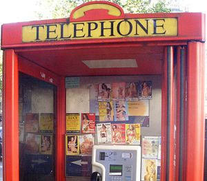 Tart cards in a British phone box advertising ...