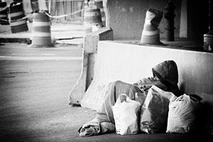 Homeless man in New York 2008, Credit Crises. ...