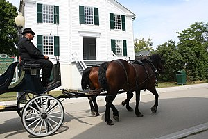 English: A carriage passing by the Mission Chu...