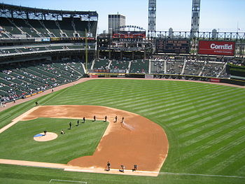 U.S. Cellular Field, grounds crew preparing th...
