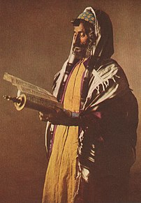 A Yemenite Jew at morning prayers, wearing a k...