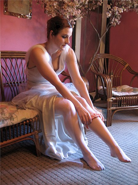 File:Bride getting dressed.jpg