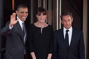 President Barack Obama is greeted by French Pr...