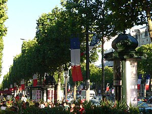 English: The Champs-Élysées decorated with fla...