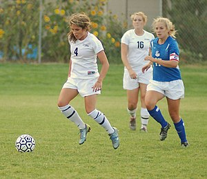 Girls playing Soccer.