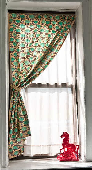 Single curtain on one side of a window, net cu...