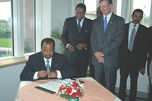 President Paul Biya of Cameroon signs the gues...