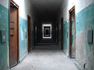 The halls of the prisoner's bunker in Dachau c...