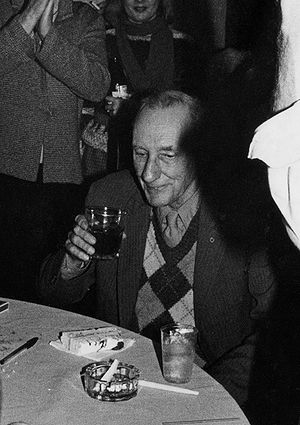 William Burroughs enjoying cake and alcohol at...