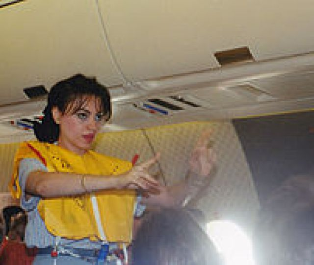 An Egyptair Flight Attendant Performing A Pre Flight Safety Demonstration