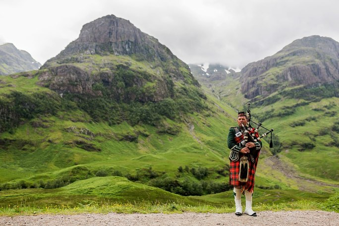 Scottish Bagpiper at Glen Coe, Scotland - Diliff