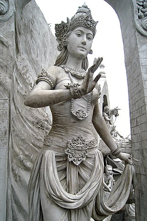The statue of a woman in regal ancient Java at...