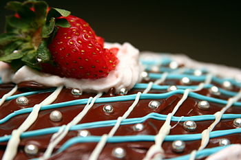 English: A chocolate cake decorated with icing...