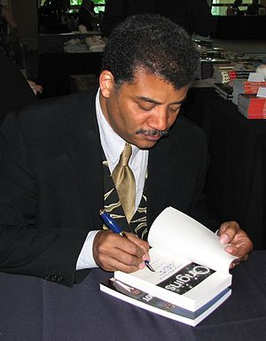 Neil deGrasse Tyson siging a copy of his book ...
