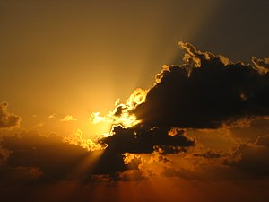The sun, behind the clouds, above the mediterr...
