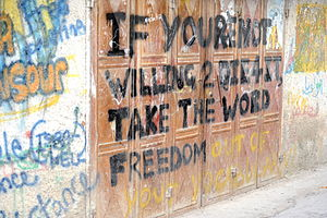 English: Graffito: 'IF YOURE NOT WILLING 2 DIE...