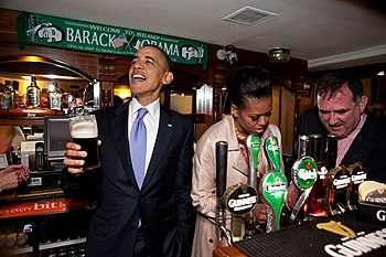 President Barack Obama talks with pub-goers as...