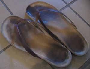 A pair of well-used flip-flops.