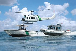 A Helicopter and two boats of the U.S. Customs...