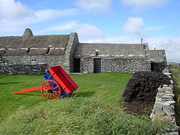 Shetland Crofthouse Museum, with peat stacked outside