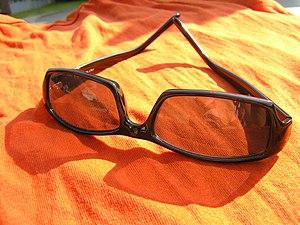 Sunglasses on blanket
