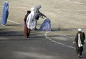 Public execution of a woman by Taliban members, Afghanistan, Nov. 1999.