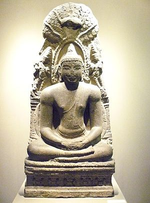 Sculpture of the Buddha meditating under the B...