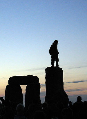 Stonehenge Summer Solstice man on stones