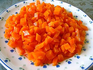English: Carrot tzimmes with honey.
