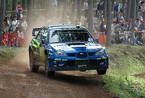 Chris Atkinson driving a Subaru Impreza WRC at...