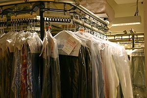 English: Many dry cleaners place cleaned cloth...
