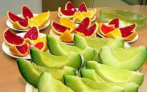 The photo contains orange, lemon, strawberry a...