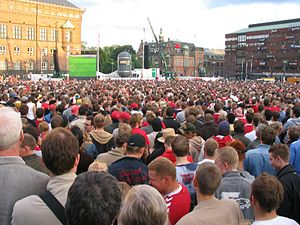 A crowd of people in the main square of Copenh...
