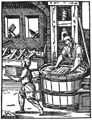 English: Papermaking by hand. Woodcut.