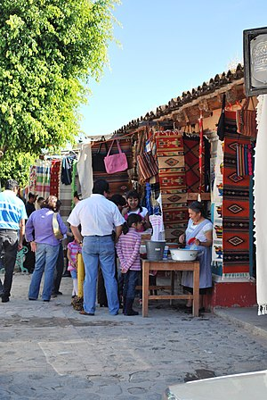 English: Rugs and other textiles for sale in t...