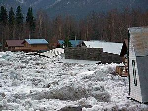 Massive ice blocks and flooding inundate the t...