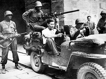 Soldiers of the 92nd Infantry Division with a ...