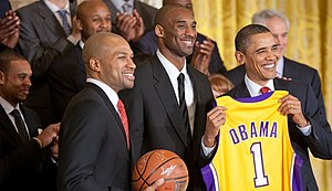 President Barack Obama holds a personalized te...