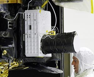 A NASA engineer and the CRISM instrument.