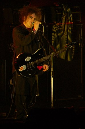 Robert Smith playing live with The Cure at The...