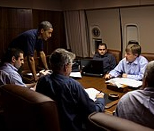 President Barack Obama Is Briefed During A Flight To Moscow