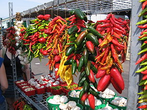 Ristras of jalapeños, other chili peppers, and...